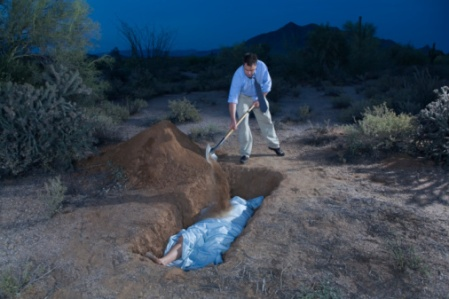 200563630-003-man-burying-body-in-shallow-grave-in-gettyimages