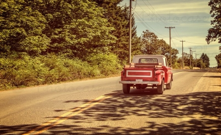 1236759-pick-up-truck-redold-fashioned-man-summer-far-off-places-photocase-stock-photo-large